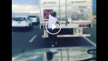 Man removes Confederate Flag on a truck