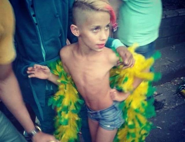 young boy at pride