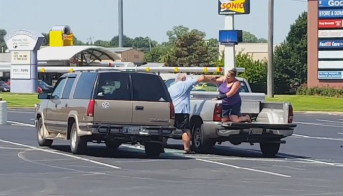 husband beating wife in parkinglot