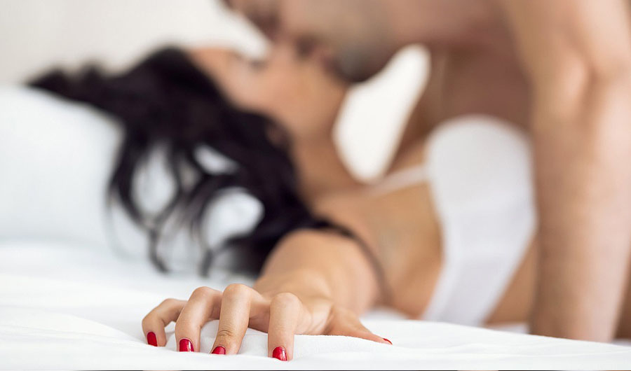 Man And Wife Making Love In Bed