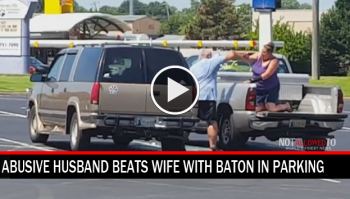 husband beats wife with baton