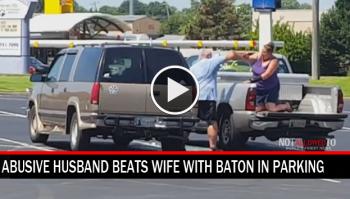 husband beats wife with baton