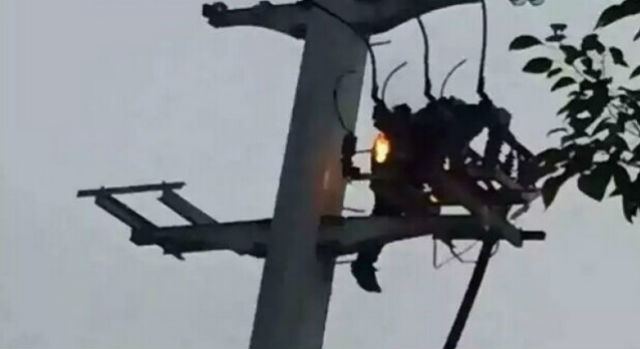 man on live wores pole
