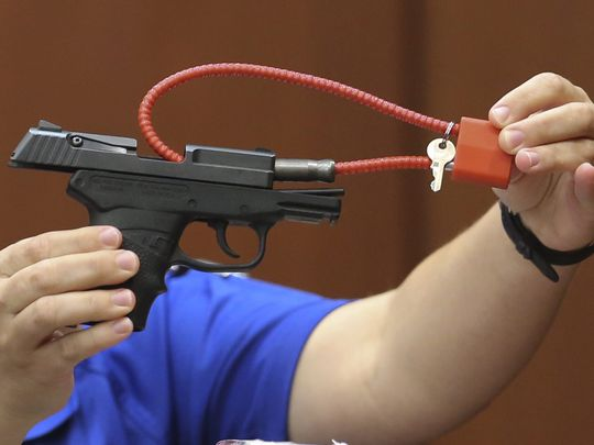The Kel-Tec PF-9 is displayed on online auction site Gunbroker.com, with a picture of a court officer holding up the gun at his murder trial.